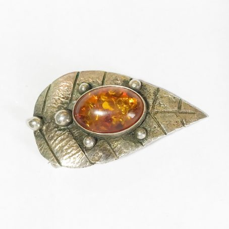 modernist silver brooch with natural amber
