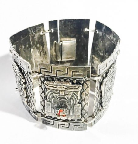 silver and coral antique bracelet with aztec figures