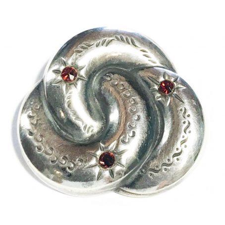 spilla art deco in argento con granati