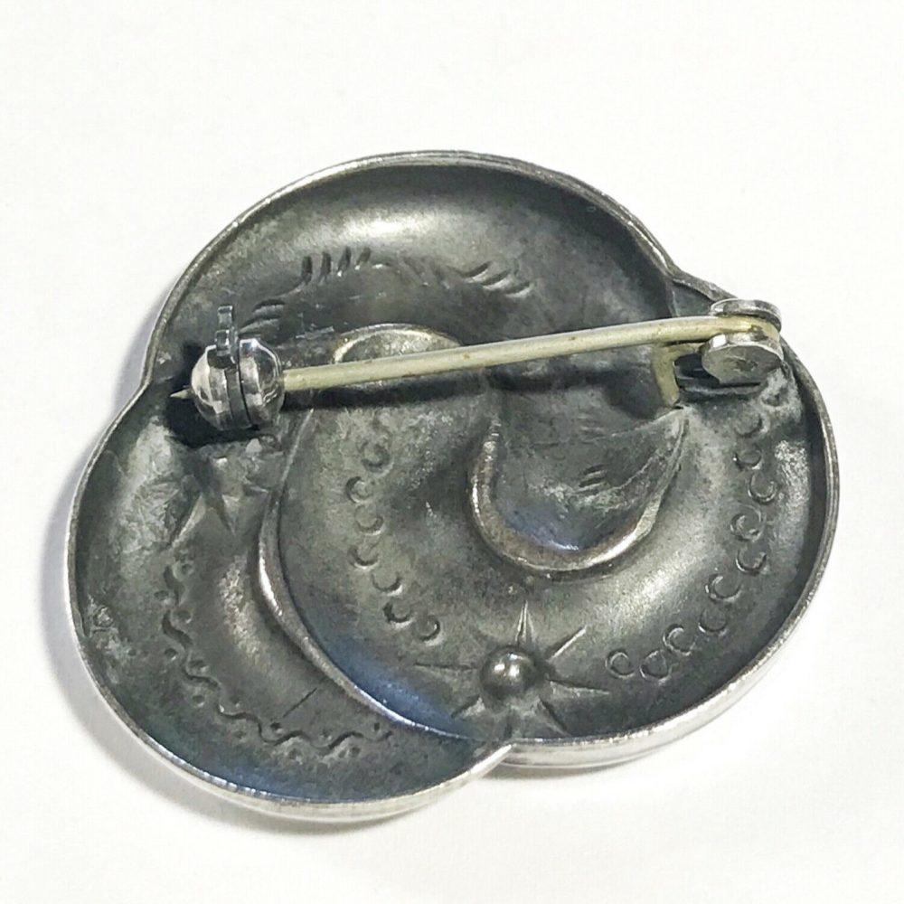 spilla art deco in argento e granati dettagli